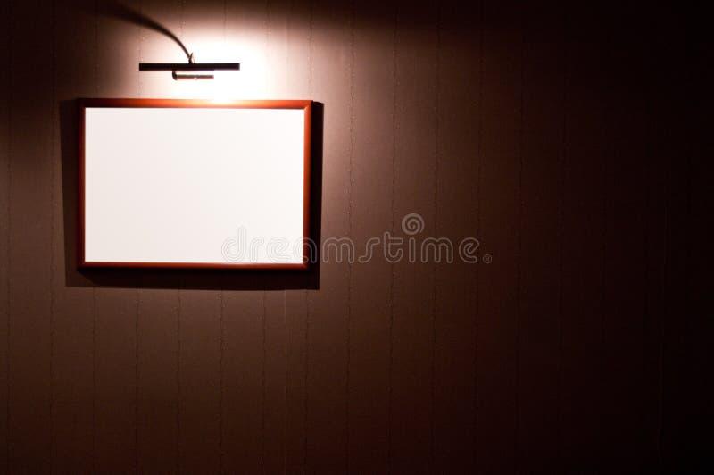 Marco en blanco en la pared fotografía de archivo libre de regalías