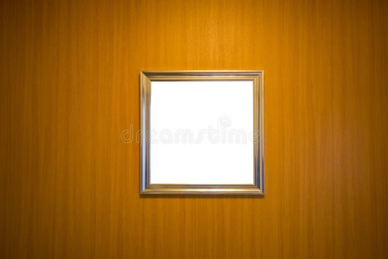 Marco en blanco en la pared de madera fotos de archivo libres de regalías