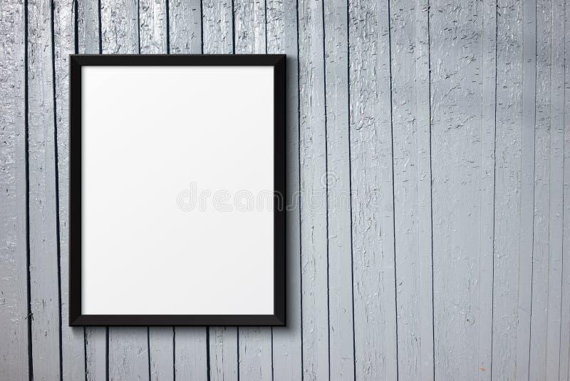 Marco negro en blanco en la madera pintada imágenes de archivo libres de regalías