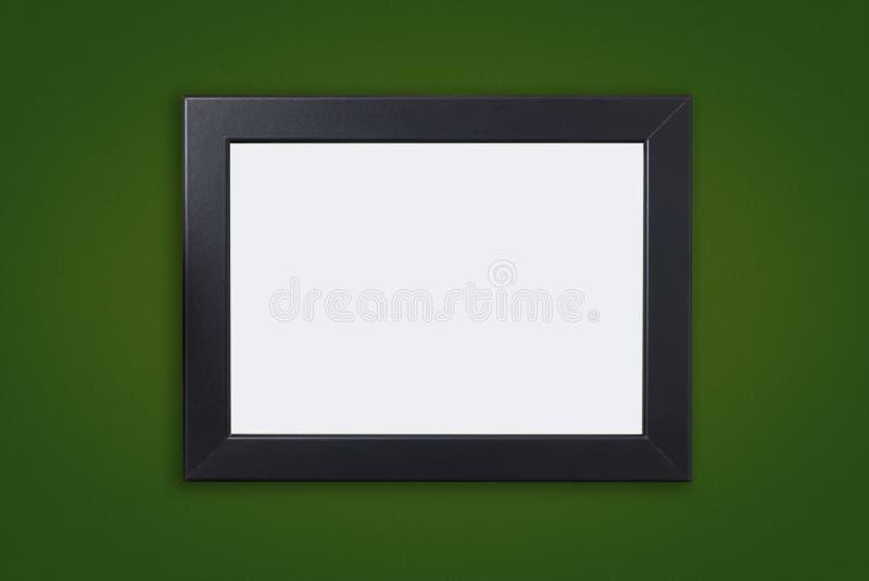 Marco negro grueso en blanco de la foto en verde imagen de archivo
