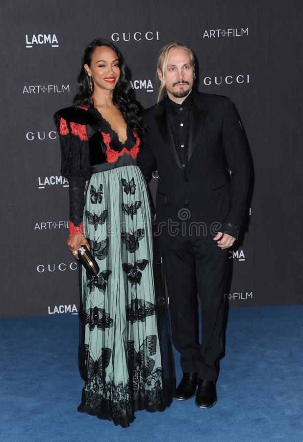 Marco Perego and  Zoe Saldana stock photography