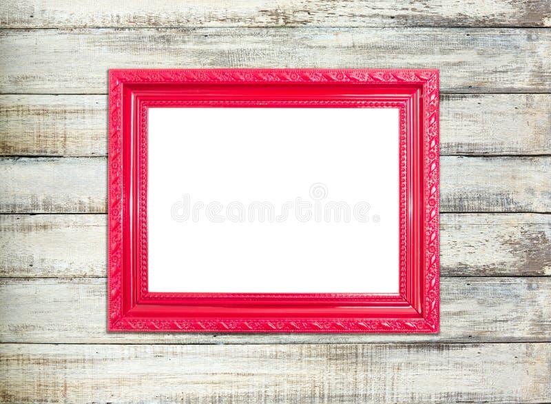 Marco rojo del vintage en viejo fondo de madera foto de archivo