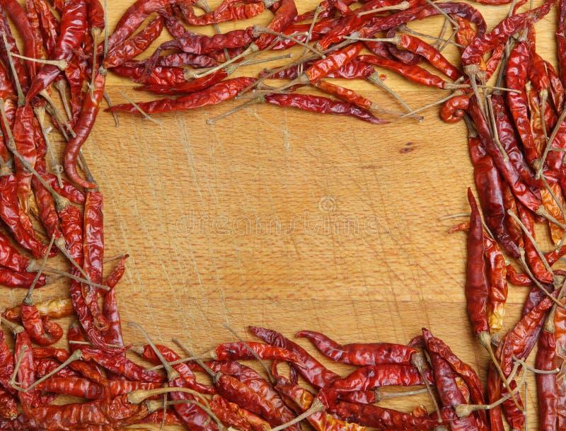 Marco rojo secado de los chiles foto de archivo