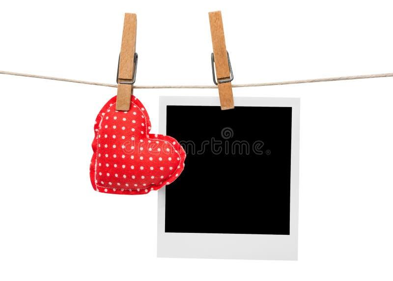 Marco y corazón de la foto imagen de archivo