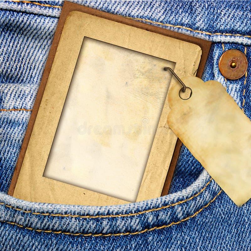 Marco y pantalones vaqueros de papel imagen de archivo