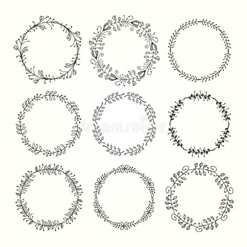 Marcos decorativos dibujados mano del vintage hechos de elementos florales ilustración del vector
