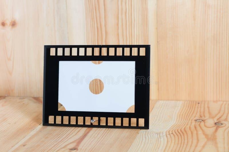 Marcos en el piso de madera foto de archivo libre de regalías