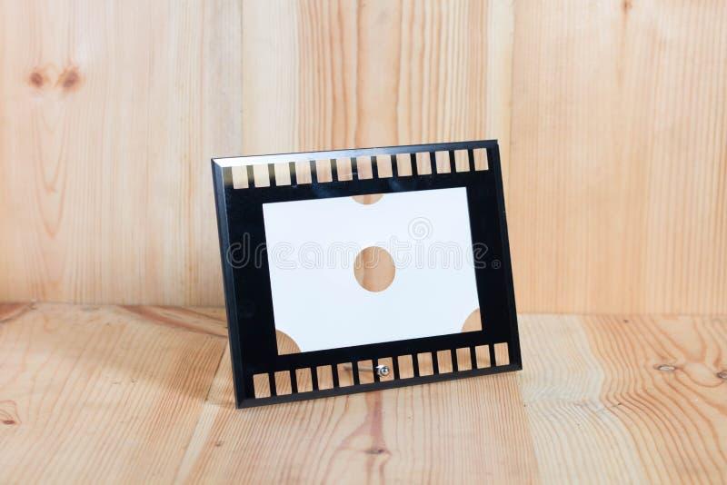 Marcos en el piso de madera imágenes de archivo libres de regalías