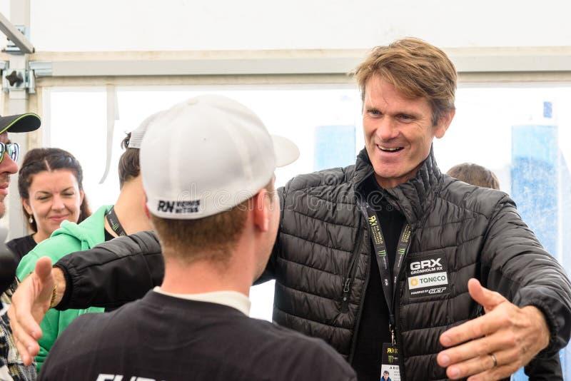 Marcus Gronholm congratulates Reinis Nitiss with European Champion for EURO Supercar. 16.09.2018. RIGA, LATVIA. Marcus Gronholm congratulates Reinis Nitiss with royalty free stock photo