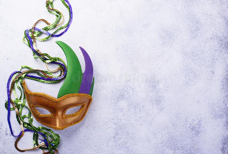 Mardi Gras background with carnival mask. Carnival masks in purple, green and gold color. Mardi Gras background royalty free stock photography