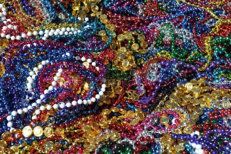 Mardi Gras Beads Background. New Orleans Mardi Gras Beads Background royalty free stock photos
