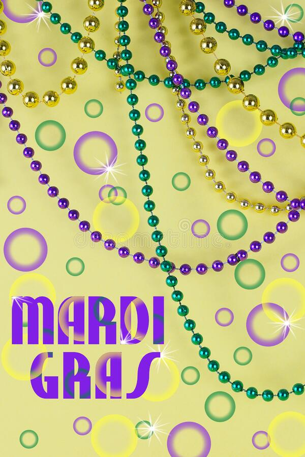 Mardi Gras beads in green, gold and purple hanging, draped in front of a yellow background. royalty free stock images