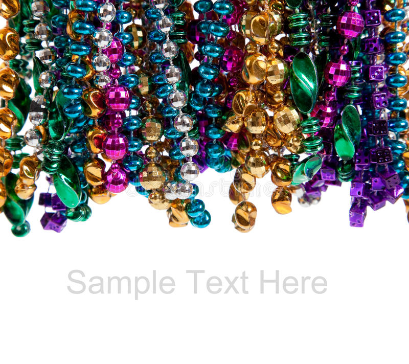 Free Mardi Gras Beads On White With Copy Space Royalty Free Stock Photos - 12145338