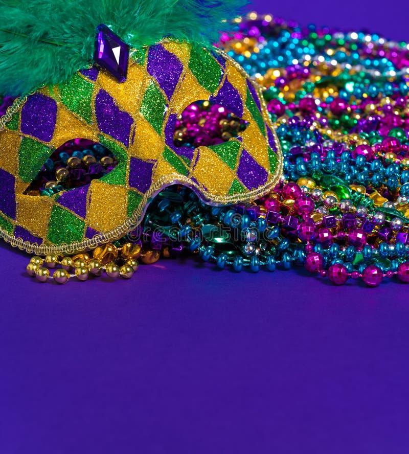 Mardi Gras or carnival mask on purple background. Mardi Gras or carnival mask on bright purple background royalty free stock photos