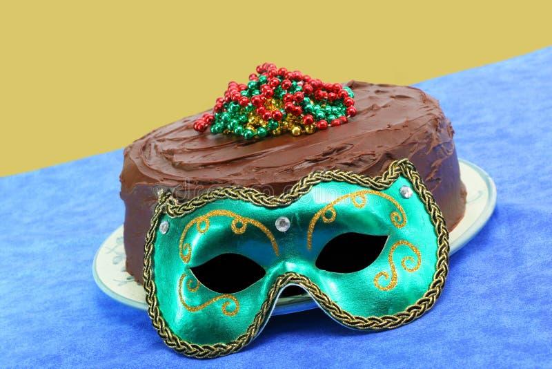 Mardi Gras Chocolate Doberge Cake with Mask royalty free stock image