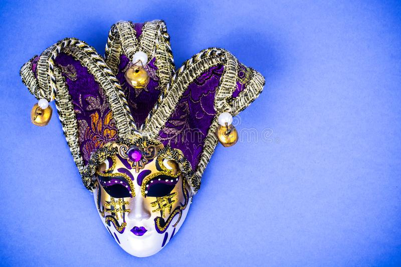 Mardi Gras Festival. Luxurious masquerade Venetian carnival mask on purple background royalty free stock images