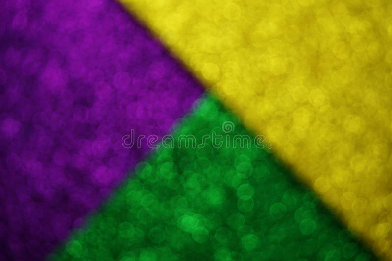 Mardi Gras with Green Purple and gold Light bokeh Background stock photography