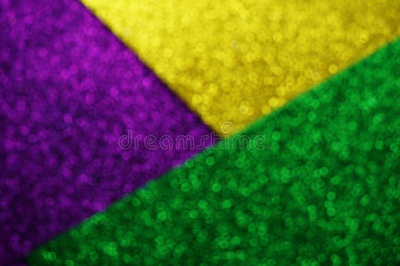 Mardi Gras with Green Purple and gold Light bokeh Background stock photos
