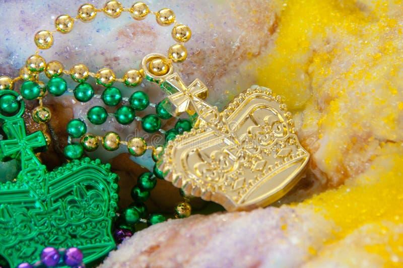 Mardi gras king cake. Mardi gras cake with beads stock photography