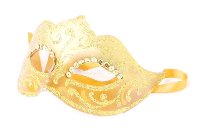Mardi gras mask. Masquerade female gold mask isolated on a white background stock photo