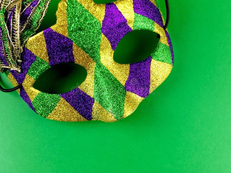 Mardi Gras. Mask and beads on a green background royalty free stock images