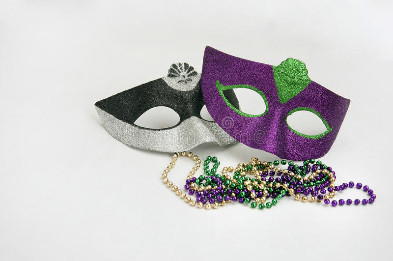 Mardi gras mask and necklaces. Two mardi gras mask and necklaces stock image
