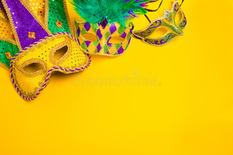 Mardi Gras Mask on yellow Background stock photography