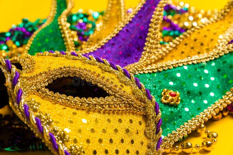 Mardi Gras Mask on yellow Background. A venetian, mardi gras mask or disguise on a yellow background stock photos