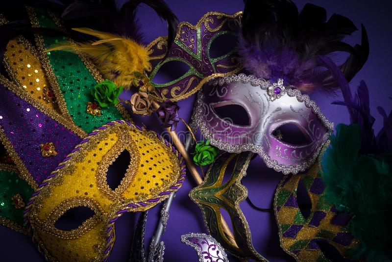 Mardi Gras masks on a dark background. Multiple Mardi Gras masks on a dark background stock photo