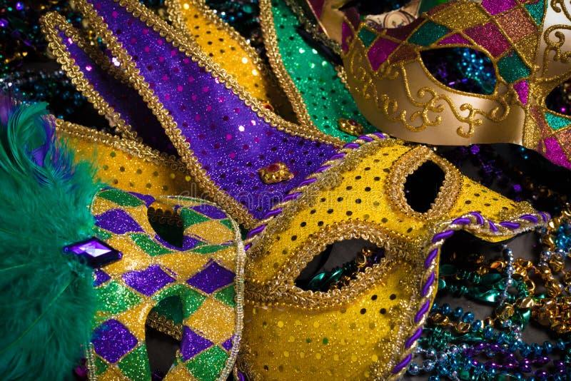 Mardi Gras Masks on dark Background. A venetian, mardi gras mask or disguise on a dark background royalty free stock photos