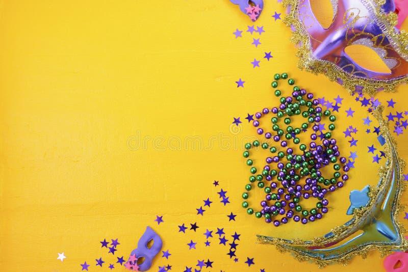 Mardi Gras masks with party decorations. Mardi Gras masks with party decorations, beads and glitte stars royalty free stock image