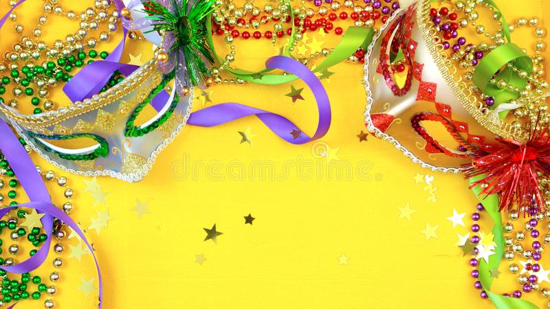 Mardi Gras overhead background with colorful masks and beads royalty free stock photo