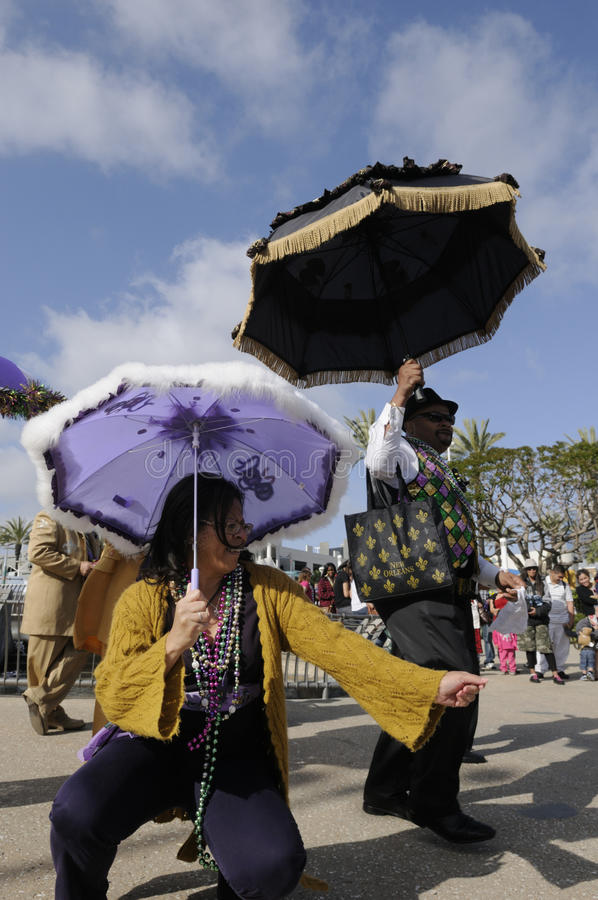 Mardi Gras parade. Mardi gras is French for Fat Tuesday, it dates back thousands of years to pagan spring & fertility rites. Participants dance before the parade stock photos