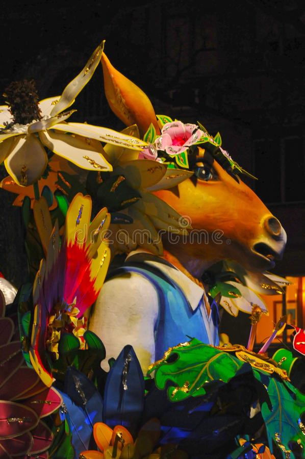 Mardi Gras parade float. Nighttime parade on St. Charles Street in New Orleans, Louisiana during Mardi Gras royalty free stock image
