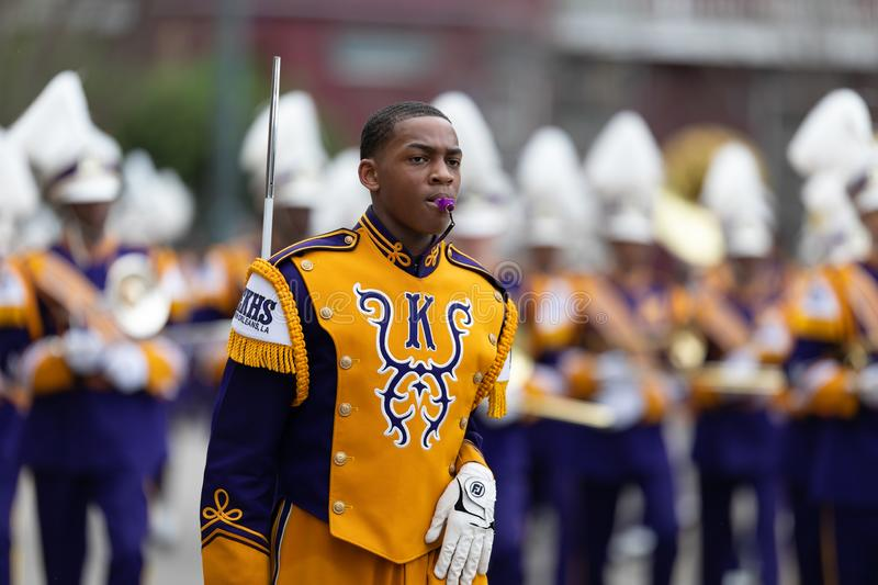 Mardi Gras Parade New Orleans. New Orleans, Louisiana, USA - February 23, 2019: Mardi Gras Parade, The Edna Karr High School Marching Cougars, performing at the royalty free stock image