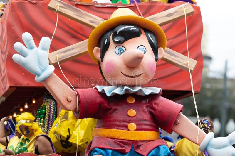 Mardi Gras Parade New Orleans. New Orleans, Louisiana, USA - February 23, 2019: Mardi Gras Parade, Float with a sculpture of Pinocchio at the mardi gras parade stock photos