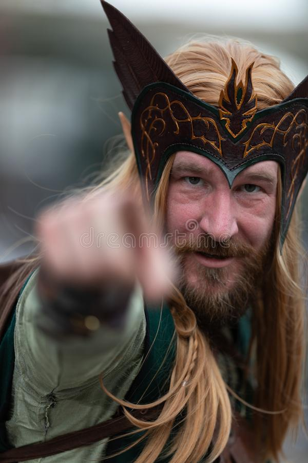 Mardi Gras Parade New Orleans. New Orleans, Louisiana, USA - February 23, 2019: Mardi Gras Parade, Man dress up as an Elf, looks and points at the camera during royalty free stock photography