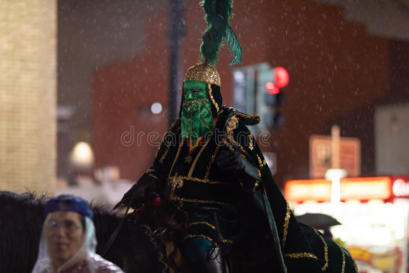 Mardi Gras Parade New Orleans. New Orleans, Louisiana, USA - February 23, 2019: Mardi Gras Parade, Man wearing traditional mardi gras clothing, riding a horse royalty free stock image