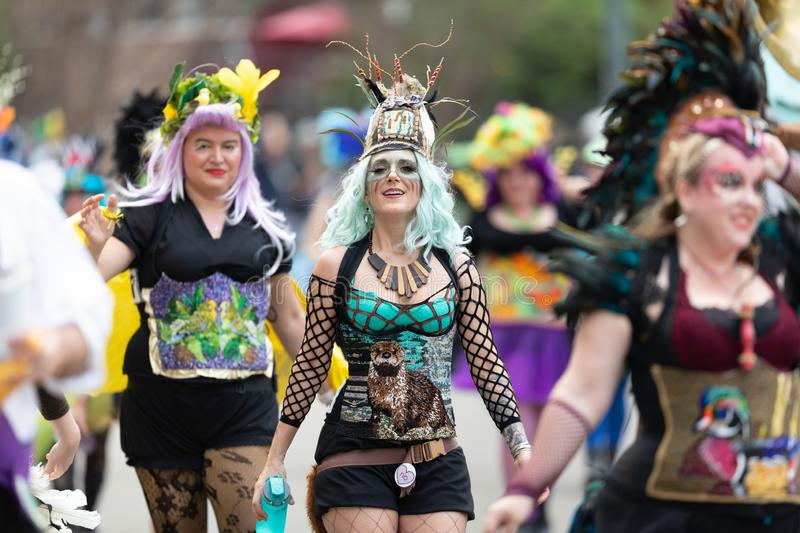 Mardi Gras Parade New Orleans. New Orleans, Louisiana, USA - February 23, 2019: Mardi Gras Parade, Members of The Dames De Perlage, Wearing colorful outfits royalty free stock photos