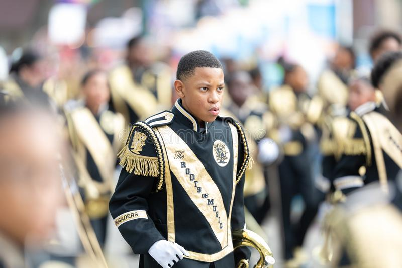Mardi Gras Parade New Orleans. New Orleans, Louisiana, USA - February 23, 2019: Mardi Gras Parade, The Roots Of Music Marching Crusaders Performing at the parade stock images