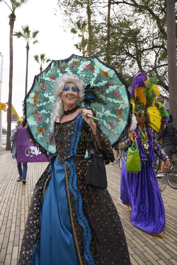 Mardi Gras parade. A women with a parasol during the annual Mardi Gras parade in Long Beach CA royalty free stock image