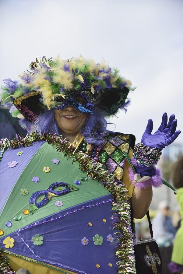 Mardi Gras parade. Women with umbrella, Long Beach Mardi Gras parade royalty free stock photo