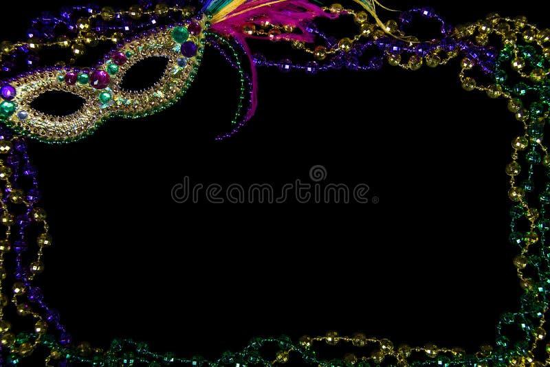 Mardi Gras-Perlenrahmen auf Schwarzem lizenzfreie stockfotografie