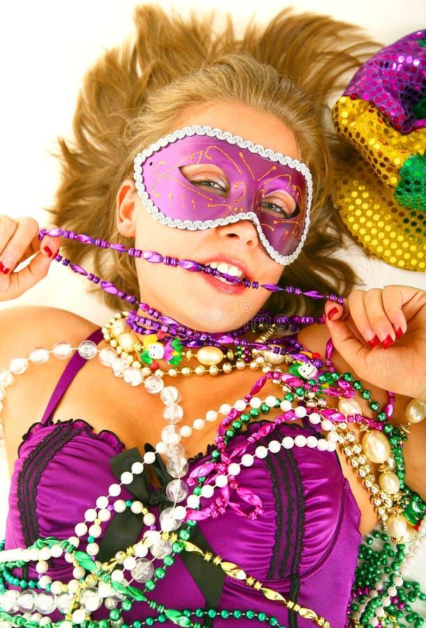 Mardi Gras Queen Bitting Beads royalty free stock image