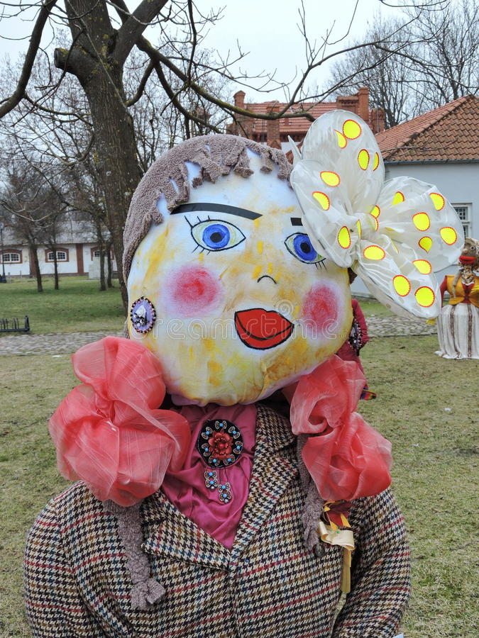 Mardi Gras woman mask. Mardi Gras mask made from fabric with painted face, Lithuania royalty free stock photos