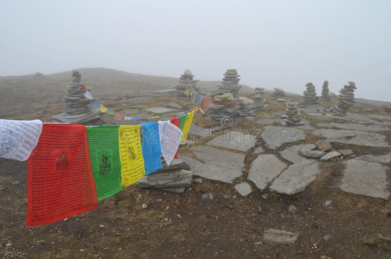 Mardi Himal Base Camp in Nepal, Annapurna region. Prayer flags in fog. stock images