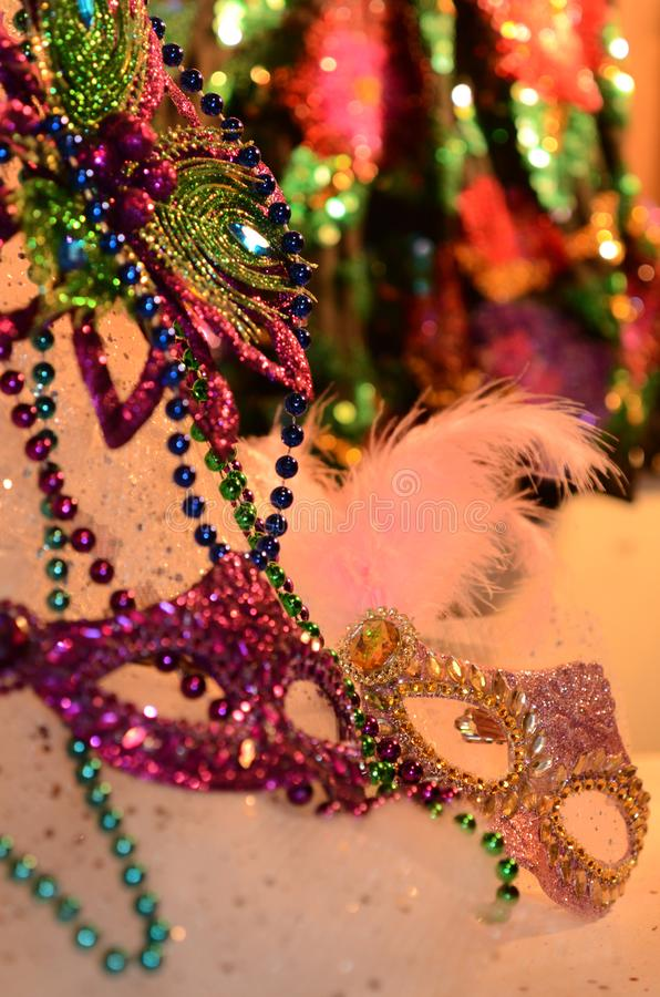 Mardi Gras mascarade glam and glitter. Celebrating and party table with festive atmosphere image with copyspace. Mardi Gras, or Fat Tuesday, refers to events of royalty free stock photography