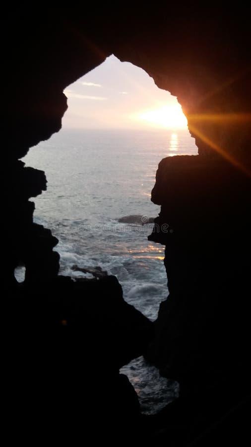 mare di tramonto di Tangeri del hercule del grotte immagini stock