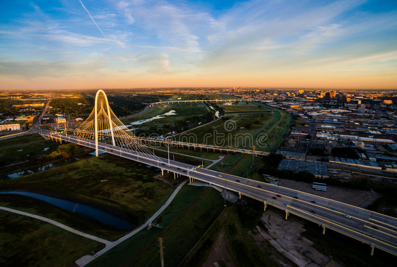 Margaret Hunt Hill Bridge Dramatic Sunrise Margaret Hunt Hill Bridge and Reunion Tower. Aerial Over Bridges Solar Flare Sunrise dramatic sunrise pink clouds with stock images