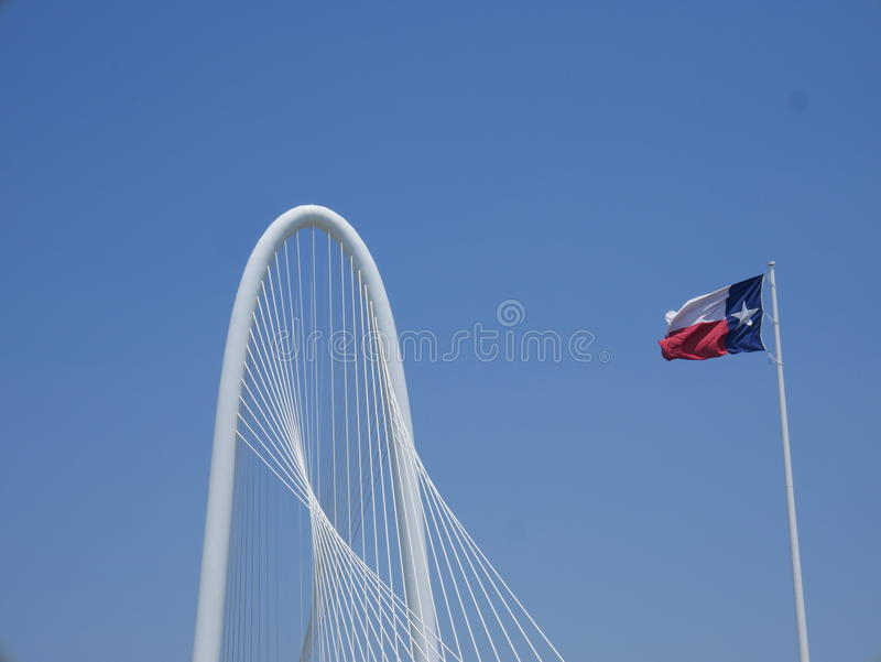 Margaret Hunt Hill bridge and Texas flag royalty free stock images